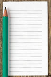 Pencil and blank lined paper Stock Photography