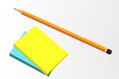 Pencil and blank note pad Stock Image