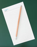 Pencil and blank notepad Stock Image