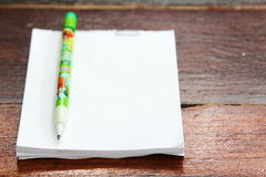 Pencil and blank notepad Royalty Free Stock Images
