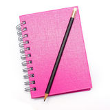Pencil on blank page of note book Stock Image