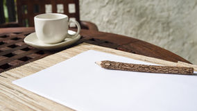 Pencil with blank paper and coffee on wooden table Stock Photography