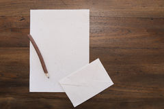 Pencil with blank  paper on old wood table Stock Photos