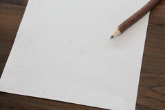 Pencil with blank  paper on old wood table Royalty Free Stock Images