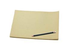 Pencil and blank sketch book Stock Photos