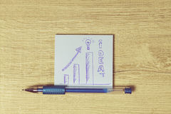 Pencil and blue post it on the desk. Royalty Free Stock Photo