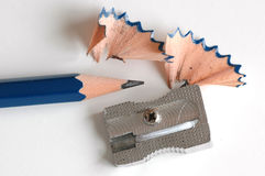 Pencil blue and sharpener. Pencil and a sharpener depicting the situation of sharpening pencils Stock Images