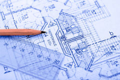 Pencil on Blueprint. Pencil on colored plan Royalty Free Stock Image