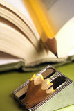 Pencil in a book 01. Pencil in a book with sharpener royalty free stock image