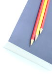 Pencil on the book. Background design Stock Images