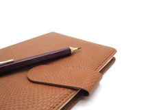 Pencil with book leatherette on white background Stock Photos