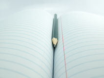 Pencil on book. Pancil on book concept hard study Royalty Free Stock Photography