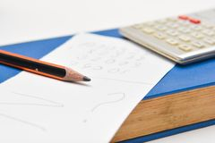Pencil, book and sheet of paper Royalty Free Stock Photos