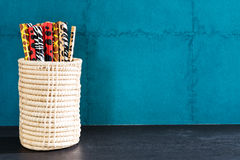 Pencil in box and on green wall background. Stock Photography