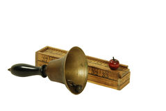 Pencil box and school bell. Creative pencil box made up of rulers and wooden apple, and an antique School bell with wooden handle and brass clapper Royalty Free Stock Photo