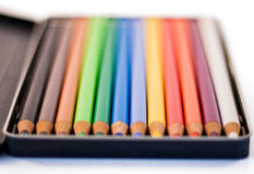 Pencil box. Box with twelve pencils. Very colorful. Selective focus. Isolated on white Stock Photo
