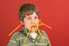 Pencil boy. Shot of a young kid goofing off - pencil boy Stock Image