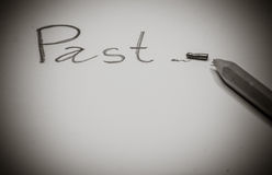 "Pencil with a broken tip on paper after wrote word "" Past "". Stock Photography"