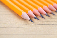 Pencil on brown paper notebook Royalty Free Stock Images