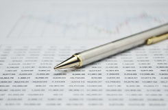Pencil on business graph, financial concept Stock Images