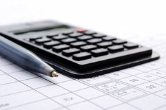 Pencil and the calculator. Isolated on the white background, chiffre Royalty Free Stock Photos