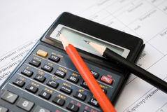 Pencil and calculator Royalty Free Stock Photos