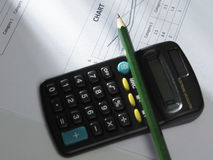 Pencil  on calculator Stock Photography
