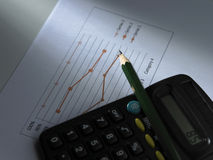 Pencil on the calculator Stock Photography