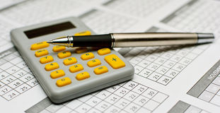 Pencil and calculator Stock Photography