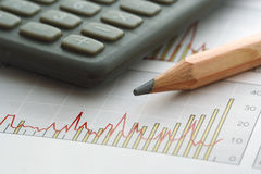 Pencil and Calculator on Chart. (focus on the tip of the pencil Royalty Free Stock Images