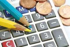 Pencil and calculator. Close up pencil and calculator Stock Photo