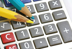 Pencil and calculator. Close up pencil and calculator Royalty Free Stock Images