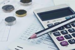 Pencil, calculator, coin and saving book on graph paper, saving Royalty Free Stock Photos