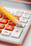 Pencil and calculator Royalty Free Stock Image