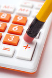 Pencil and calculator Stock Images