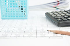 Pencil and calculator on finance account with stack old paperwork Stock Photography