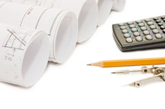 Pencil and calculator isolated over white Stock Images