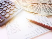 Pencil, calculator, money and savings account passbook or financial statement on white background Stock Images