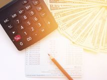 Pencil, calculator, money and savings account passbook or financial statement on white background Stock Photography