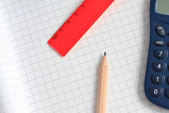 Pencil, calculator and spacer Stock Photography