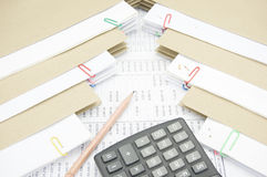 Pencil and calculator between stack paperwork report with envelope Royalty Free Stock Photos