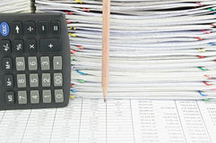 Pencil and calculator in vertical on finance report Stock Photo