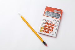 Pencil and calculator Royalty Free Stock Photos