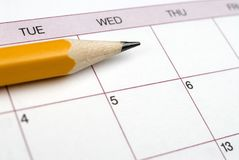 Pencil on a Calendar. Closeup image of pencil laying on a calendar stock image