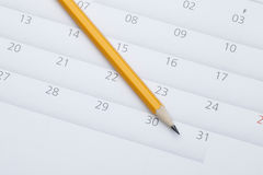 Pencil on calendar. A yellow pencil on the calendar Royalty Free Stock Images
