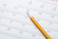 Pencil on calendar. A yellow pencil on the calendar Stock Images