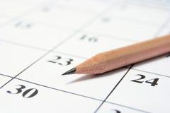 Pencil on Calendar. Close Up of Pencil on Calendar Stock Images