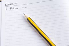 Pencil on a calendar Stock Images