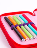 Pencil case with bright colored pens Royalty Free Stock Photo
