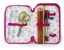 Pencil case. Coloured pencils, pencil, ruler, scissors, pens and rubber in a case for girl Stock Photos